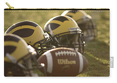 Helmets And A Football On The Field At Dawn Carry-all Pouch