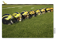 Helmets Of Different Eras On The Field Carry-all Pouch