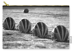 Helmets On Dew-covered Field At Dawn Black And White Carry-all Pouch