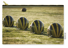 Helmets On Dew-covered Field At Dawn Carry-all Pouch