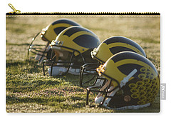 Helmets On The Field At Dawn Carry-all Pouch