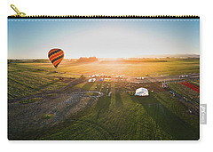 Carry-all Pouch featuring the photograph Hot Air Balloon Taking Off At Sunrise by William Lee