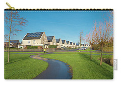 Carry-all Pouch featuring the photograph Houses With Solar Panels by Hans Engbers