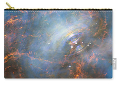 Carry-all Pouch featuring the photograph Hubble Captures The Beating Heart Of The Crab Nebula by Nasa