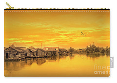 Carry-all Pouch featuring the photograph Huts Yellow by Charuhas Images