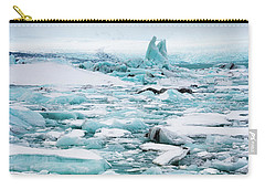 Carry-all Pouch featuring the photograph Ice Galore In The Jokulsarlon Glacier Lagoon Iceland by Matthias Hauser