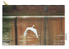 Carry-all Pouch featuring the photograph In Flight by Kim Henderson