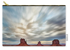 Carry-all Pouch featuring the photograph In The Clouds by Jon Glaser