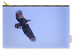 Carry-all Pouch featuring the photograph Juvie Bald Eagle With Fish In Flight by Jeff at JSJ Photography