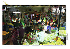 Carry-all Pouch featuring the photograph Koyambedu Flower Market Stalls by Mike Reid