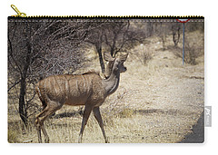 Carry-all Pouch featuring the photograph Kudu Crossing by Ernie Echols