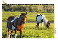 Carry-all Pouch featuring the photograph Leaving The Chincoteague Ponies by Belinda Greb