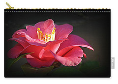 Carry-all Pouch featuring the photograph Lighted Camellia by AJ Schibig