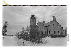 Carry-all Pouch featuring the photograph Lighthouse And Mackinac Bridge Winter Black And White  by John McGraw