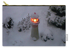 Carry-all Pouch featuring the photograph Lighthouse In The Snow by Kathryn Meyer