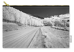 Carry-all Pouch featuring the photograph Long Road In Colorado by Jon Glaser