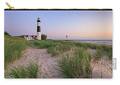 Carry-all Pouch featuring the photograph Ludington Beach And Big Sable Point Lighthouse by Adam Romanowicz