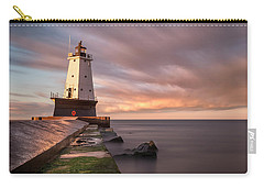 Carry-all Pouch featuring the photograph Ludington Light Sunrise Long Exposure by Adam Romanowicz