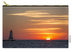 Carry-all Pouch featuring the photograph Ludington North Breakwater Light At Sunset by Adam Romanowicz