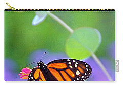Carry-all Pouch featuring the photograph Magical Monarch by Byron Varvarigos