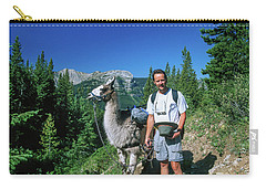 Man Posing With A Llama On A High Mountain Trail Carry-all Pouch by Jerry Voss