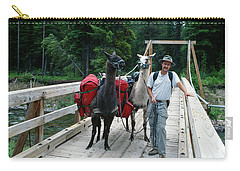 Man Posing With Two Llamas On Wilderness Drawbridge Carry-all Pouch by Jerry Voss