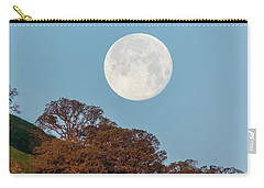 Carry-all Pouch featuring the photograph March Moonset by Marc Crumpler