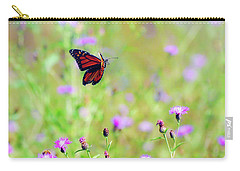 Carry-all Pouch featuring the photograph Monarch Butterfly In Flight Over The Wildflowers by Kerri Farley