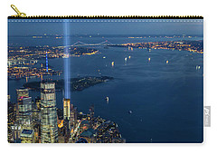 Carry-all Pouch featuring the photograph New York City Remembers 911 by Susan Candelario