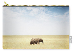 One Elephant Walking In Grass In Africa Carry-all Pouch