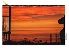 Carry-all Pouch featuring the photograph Orange Balcony Sunset by Bob Slitzan