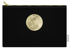 Carry-all Pouch featuring the photograph over a Ga moon by Aaron Martens