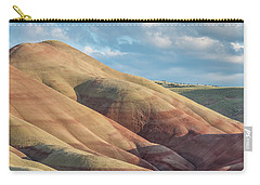 Carry-all Pouch featuring the photograph Painted Hill And Clouds by Greg Nyquist