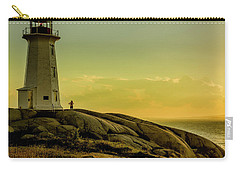Peggys Cove Lighthouse At Sunset  Carry-all Pouch by Ken Morris