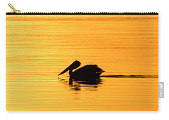 Carry-all Pouch featuring the photograph Pelican Cruising At Sunset In Key West by Bob Slitzan
