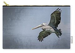 Carry-all Pouch featuring the photograph Pelican Flight by Carolyn Marshall