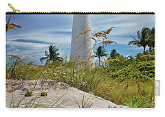 Pelican Flying Over Cape Florida Lighthouse Carry-all Pouch by Justin Kelefas