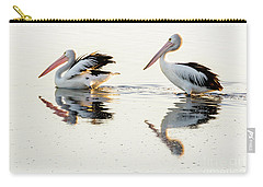 Pelicans At Dusk Carry-all Pouch by Werner Padarin