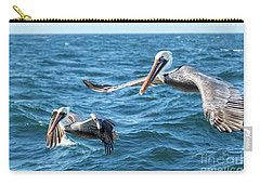 Carry-all Pouch featuring the photograph Pelicans Flying by Robert Bales