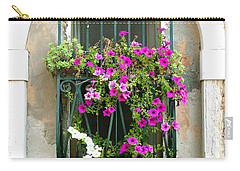 Carry-all Pouch featuring the photograph Petunias Through Wrought Iron by Donna Corless