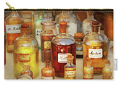 Carry-all Pouch featuring the photograph Pharmacy - Serums And Elixirs by Mike Savad