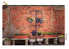 Carry-all Pouch featuring the photograph Potted Plants And A Brick Wall by James Eddy