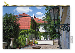 Carry-all Pouch featuring the photograph Prague Courtyards. Old Lantern by Jenny Rainbow