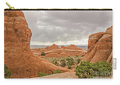 Carry-all Pouch featuring the photograph Rain In The Distance At Arches by Sue Smith