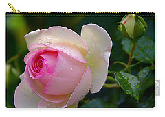 Carry-all Pouch featuring the photograph Rain-kissed Rose by Byron Varvarigos