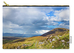 Carry-all Pouch featuring the photograph Raining Down And Sunshine With Rainbow On The Countryside In Ire by Semmick Photo