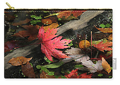 Carry-all Pouch featuring the photograph Red Maple Leaf In Pond by Doris Potter