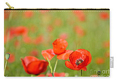 Red Poppy In A Field Of Poppies Carry-all Pouch by IPics Photography