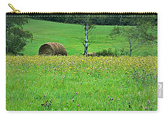 Carry-all Pouch featuring the photograph Round Bale And Wildflowers by Joy Nichols