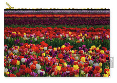 Carry-all Pouch featuring the photograph Rows Of Tulips by Susan Candelario